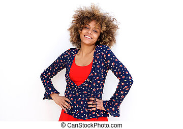 happy young african american woman standing by white background