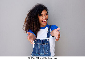happy young african american woman welcoming with open arms
