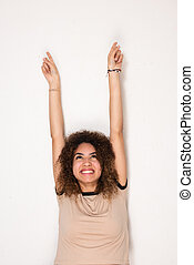 happy young african american woman with arms raised and looking up