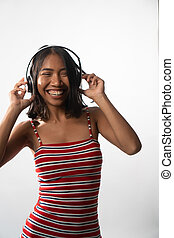 Portrait of happy young Asian girl with headphones isolated over white wall