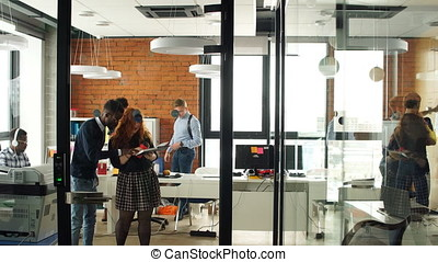 Portrait of happy young business team in modern office. Work in loft interior.