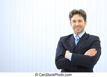 Portrait of happy young businessman at office