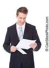 Young Businessman Reading Document Over White Background