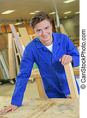 Portrait of happy young carpenter