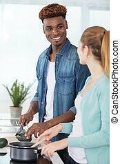 portrait of happy young couple cooking together