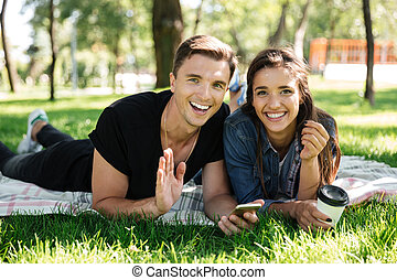 Portrait of happy young couple drinking coffee
