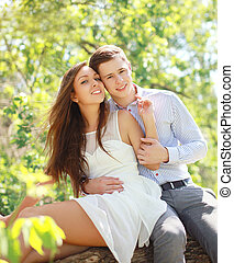 Portrait of happy young couple in love, sunny summer day