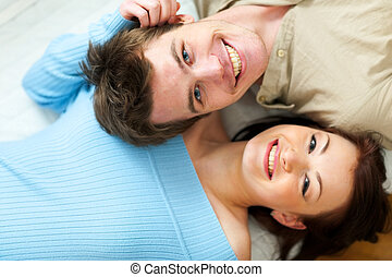 Portrait of happy young couple