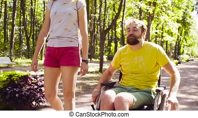 Portrait of happy young disable man on a walk in the park