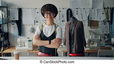 Portrait of happy young lady fashion designer smiling...