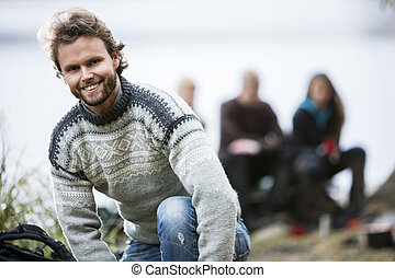 Portrait Of Happy Young Man At Campsite