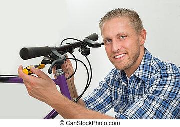 Man Repairing Bicycle Handlebar