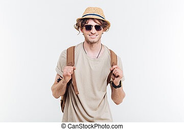 Portrait of happy young man with backpack over white background