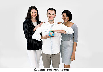 Portrait of happy young multiethnical businesspeople, African and Caucasian women, Caucasian man holding earth globe model. Diverse group of people on white background. Happy Earg day