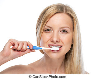 Portrait of happy young woman brushing teeth