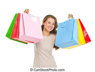 Portrait of happy young woman holding shopping bags