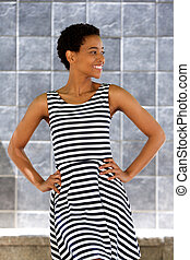 happy young woman in striped dress
