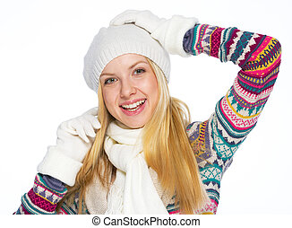 Portrait of happy young woman in winter clothes