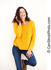 happy young woman laughing against white background