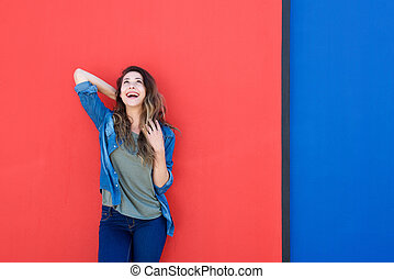 happy young woman laughing and looking up