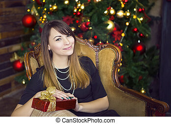 Portrait of happy young woman near the Christmas tree