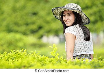 young woman relaxing in the garden
