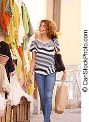 happy young woman shopping for clothes