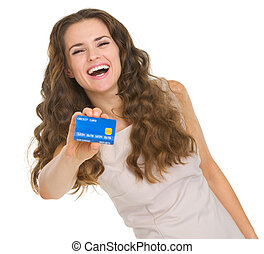 Portrait of happy young woman showing credit card