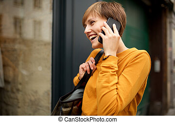happy young woman talking with cellphone