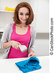 Young Woman Using Barcode Scanner