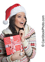 Portrait of happy young woman with Christmas present