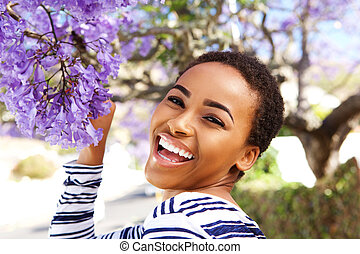 happy young woman with flower on tree