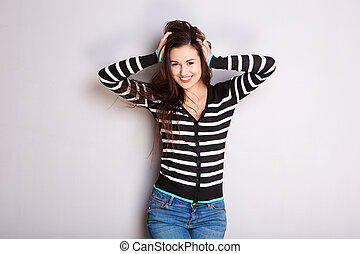 happy young woman with hands in hair