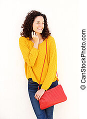 happy young woman with purse against white background