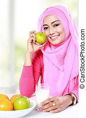 healthy breakfast of young muslim woman