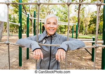 Happy Senior Woman At Outdoor Gym