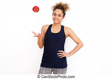 healthy sporty young african american woman with apple