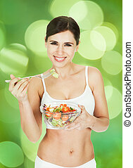 Portrait Of Healthy Woman Eating Salad