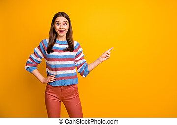 Portrait of her she nice attractive cheerful cheery glad confident girl pointing copy space advice advert isolated over bright vivid shine vibrant yellow color background