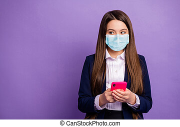 Portrait of her she nice attractive long-haired girl wearing safety gauze mask using device mers cov copy space infection prevention isolated bright vivid shine vibrant lilac violet color background