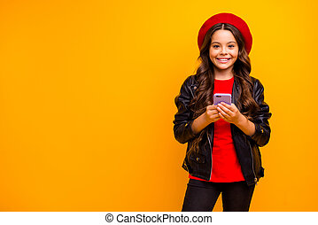 Portrait of her she nice attractive lovely cheerful cheery long-haired girl wearing streetstyle using cell free time isolated over bright vivid shine vibrant yellow color background