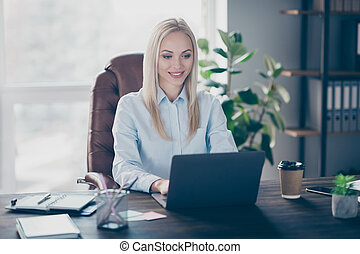 Portrait of her she nice attractive lovely cheerful focused professional girl creating presentation finance insurance salary income report sitting in chair in work place station indoors