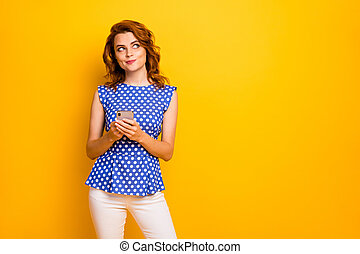 Portrait of her she nice attractive lovely creative cheerful smart clever wavy-haired girl using cell creating new smm blog idea isolated on bright vivid shine vibrant yellow color background