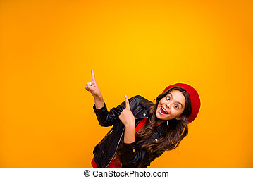 Portrait of her she nice attractive lovely excited glad cheerful cheery long-haired girl pointing up recommend decision advert isolated over bright vivid shine vibrant yellow color background