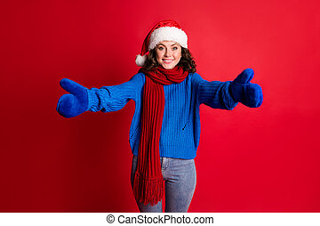 Portrait of her she nice attractive pretty cheerful cheery kind girl wearing festal Santa look hugging you invitation isolated bright vivid shine vibrant red color background