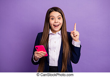 Portrait of her she nice brainy small little cheerful cheery long-haired creative girl using gadget got great idea solution isolated bright vivid shine vibrant lilac violet color background