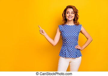 Portrait of her she nice-looking attractive lovely pretty cute girlish curious cheerful cheery wavy-haired girl showing new novelty ad isolated on bright vivid shine vibrant yellow color background