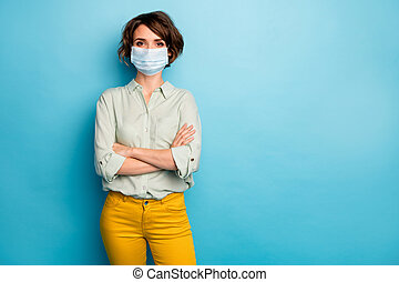 Portrait of her she nice pretty content lady wearing gauze mask folded arms stop influenza infection cov concept social distance rule isolated bright vivid shine vibrant blue color background