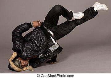 Portrait of hip hop dancer in head stand