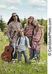 Portrait of hippie family outdoors